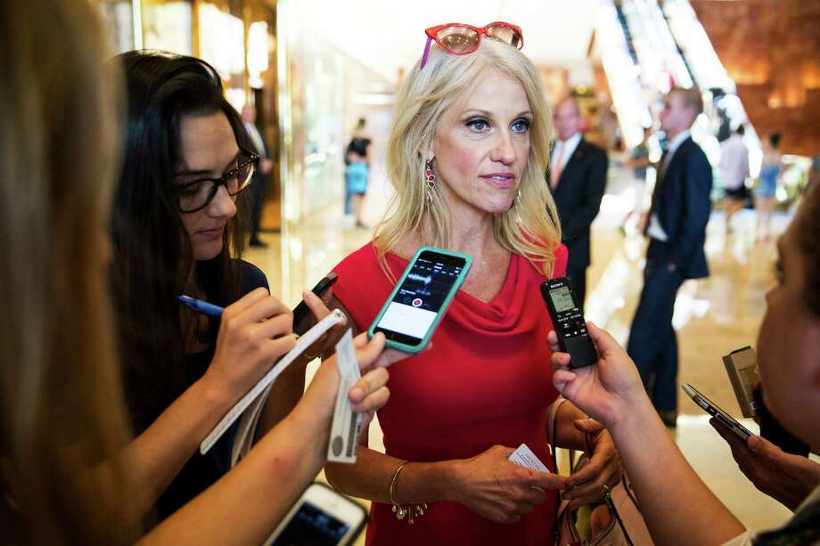 Kellyanne Conway, center, Donald Trump's new campaign manager, speaks with reporters at Trump Tower in New York, Aug. 17,  2016. Trump has shaken up his presidential campaign for the second time in two months, hiring a top executive from the conservative website Breitbart News and promoting Conway in an effort to right his faltering campaign. (Damon Winter/The New York Times) ORG XMIT: XNYT83 Photo: DAMON WINTER / NYTNS