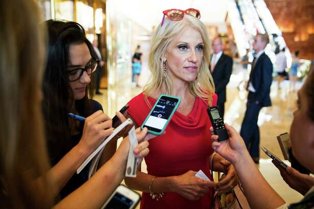 Kellyanne Conway, center, Donald Trump's new campaign manager, speaks with reporters at Trump Tower in New York, Aug. 17,  2016. Trump has shaken up his presidential campaign for the second time in two months, hiring a top executive from the conservative website Breitbart News and promoting Conway in an effort to right his faltering campaign. (Damon Winter/The New York Times) ORG XMIT: XNYT83