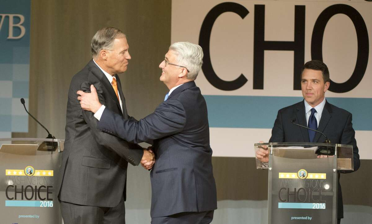 Washington Gov. Jay Inslee and Republican challenger Bill Bryant, a former Seattle Port Commissioner. The two men debated Wednesday night in Pasco, their exchanges limited by rules and one-minute time limits. Here, they are pictured at an earlier debate.. (Jesse Tinsley/The Spokesman-Review via AP)