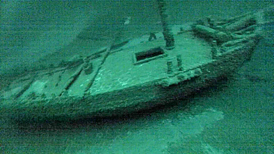 "This July 16, 2016, photo taken from underwater  video  shows the ""Washington"", which sank during a storm in 1803. The team of underwater explorers says it has found the second-oldest confirmed shipwreck in the Great Lakes, an American-built, Canadian owned-sloop that sank in Lake Ontario 213 years ago. The three-member western New York-based team says it discovered the wreck of the Washington earlier this summer in deep water off Oswego. (Roger L. Pawlowski via AP) ORG XMIT: NY111 Photo: Roger L Pawlowski / Roger L Pawlowski"