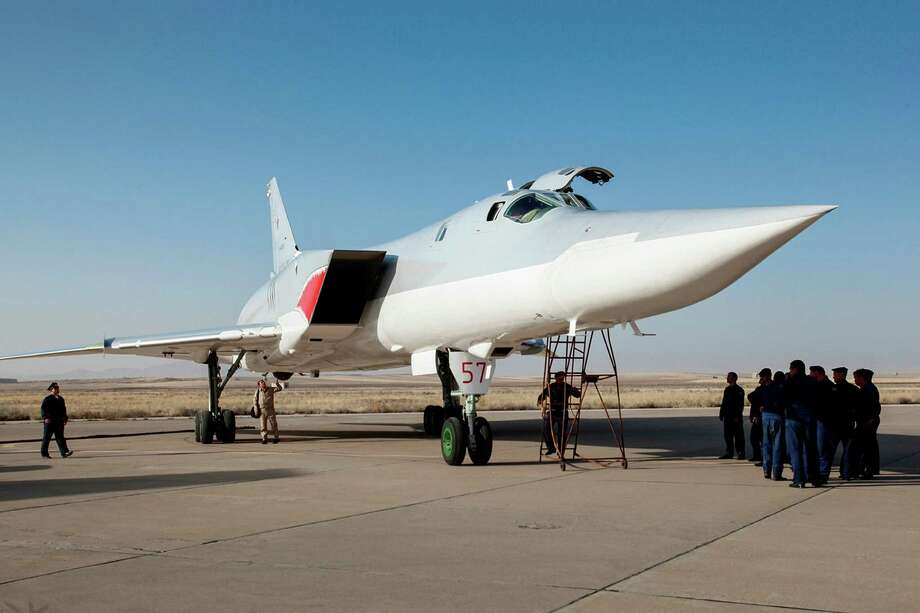 In this photo taken on Monday, Aug. 15, 2016, A Russian Tu-22M3 bomber stands on the tarmac at an air base near Hamedan, Iran. Russian warplanes took off on Tuesday Aug. 16, from Iran to target Islamic State fighters and other militants in Syria, widening Moscow's bombing campaign in Syria.(WarfareWW Photo via AP) ORG XMIT: XAZ112 / http://twitter.com/WarfareWW