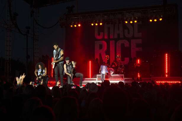 American country music singer and songwriter Chase Rice and his band perform on stage at the Midland County Fair Grandstands Wednesday evening.