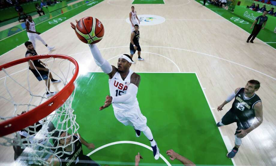 United States' Carmelo Anthony (15) shoots in front of Argentina's Andres Nocioni, right, during a quarterfinal round basketball game at the 2016 Summer Olympics in Rio de Janeiro, Brazil, Wednesday, Aug. 17, 2016. (AP Photo/Charlie Neibergall) ORG XMIT: OBKO165 Photo: Charlie Neibergall / Copyright 2016 The Associated Press. All rights reserved. This m