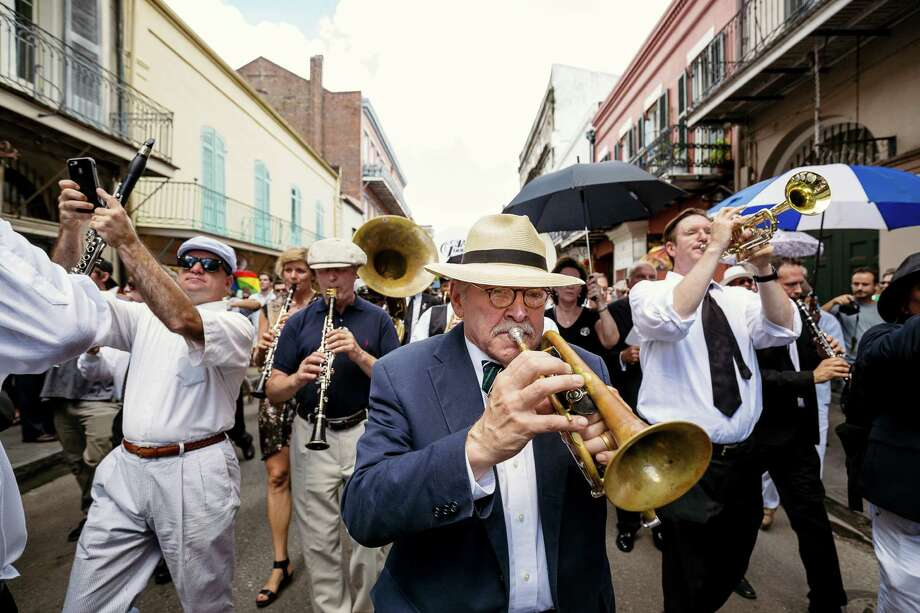 Jim Cullum Jr. plays in the second line after the the funeral for Pete Fountain, a jazz clarinet legend, in New Orleans, La., on Aug. 17. Photo: Bryan Tarnowski / For The Express-News / © Bryan Tarnowski