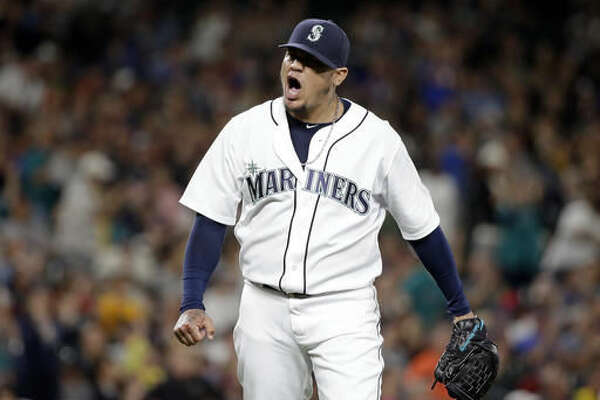 Seattle Mariners starting pitcher Felix Hernandez yells at the final out by the Detroit Tigers in the seventh inning of a baseball game Wednesday, Aug. 10, 2016, in Seattle. Hernandez did not return for the next inning. (AP Photo/Elaine Thompson)