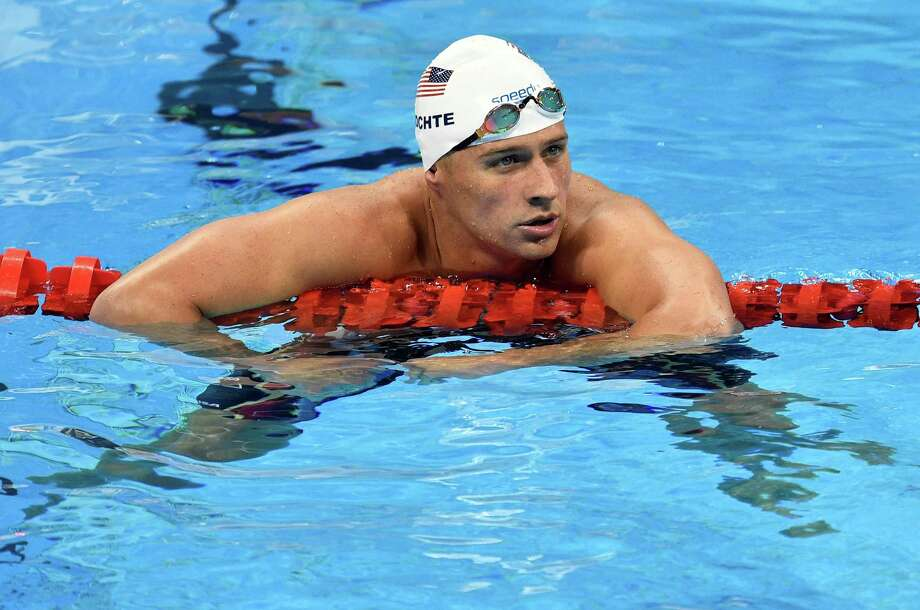FILE - In this Aug. 9, 2016, file photo, United States' Ryan Lochte checks his time after a men' 4x200-meter freestyle relay heat during the swimming competitions at the 2016 Summer Olympics in Rio de Janeiro, Brazil. The father of the American swimmer said Wednesday, Aug. 17, his son arrived back in the United States before a Brazilian judge ordered that Lochte stay in Brazil as authorities investigate a robbery claim involving the athlete during the Olympics. (AP Photo/Martin Meissner, File) Photo: Martin Meissner, STF / Associated Press / Copyright 2016 The Associated Press. All rights reserved. This material may not be published, broadcast, rewritten or redistribu