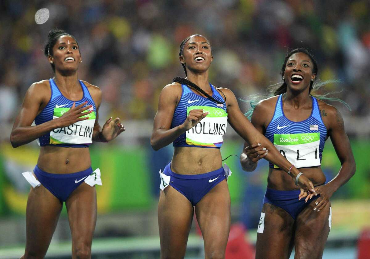 Winner Brianna Rollins, center, celebrates with runner-up Nia Ali, right, and third-place finisher Kristi Castlin after they crossed the finish line to complete a U.S. sweep of the 100-meter hurdles.