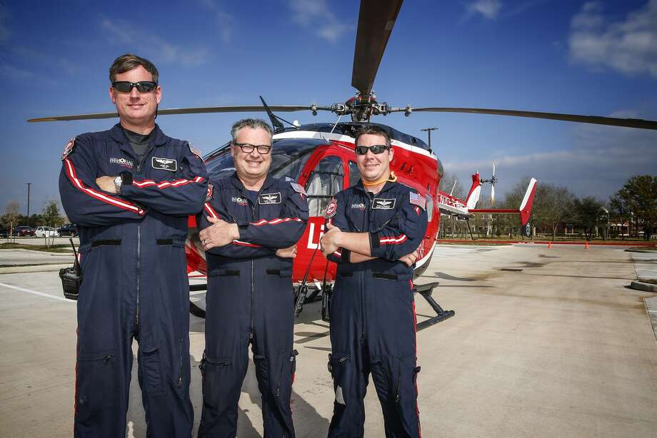 Life Flight crew for Memorial Hermann Hospital pose outside the new Cypress location, near  Highway 290 and Mason Road, in March of this year. Shown are Lewis Geil, pilot, Clint Kneuven, flight nurse and Ryan LeNorman, flight paramedic.Click through to see photos of the life-saving chopper in action over the years... Photo: Diana L. Porter, Freelance / © Diana L. Porter