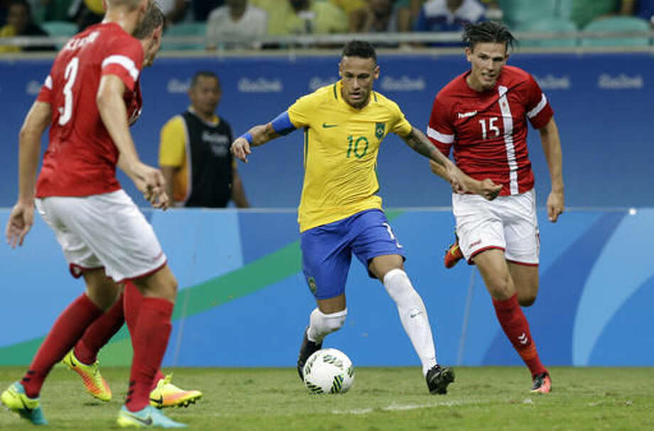Brazil's Neymar controls the ball past Denmark's Pascal Gregor during a group A match of the men' s Olympic football tournament between Brazil and Denmark in Salvador, Brazil, Wednesday Aug. 10, 2016. Brazil won the match 4-0.(AP Photo/Leo Correa) Photo: Leo Correa