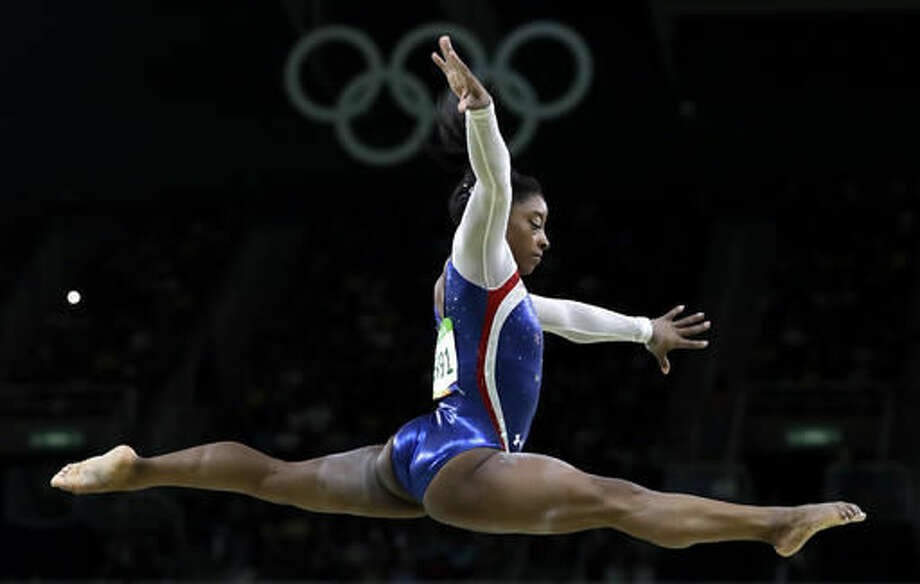 United States' Simone Biles performs on the balance beam during the artistic gymnastics women's individual all-around final at the 2016 Summer Olympics in Rio de Janeiro, Brazil, Thursday, Aug. 11, 2016. (AP Photo/Rebecca Blackwell) Photo: Rebecca Blackwell
