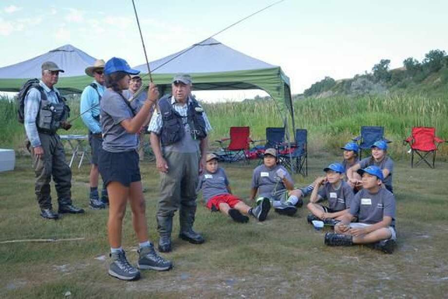 CORRECTS BYLINE TO CHRIS JORGENSEN NOT PETER HERZOG - ADVANCE FOR THE WEEKEND OF AUG. 13-14 AND THEREAFTER - In a July 30, 2016 photo, Yvon Chouinard instructs students on the use of a Tenkara rod, an ancient method of fishing that doesn't require a reel. Ann Marie Emery organized a day of fly fishing on the Bighorn for a group of seven Crow Indian students on a stretch of the river about 10 miles south of St. Xavier. (Chris Jorgensen/Billings Gazette via AP) Photo: Chris Jorgensen