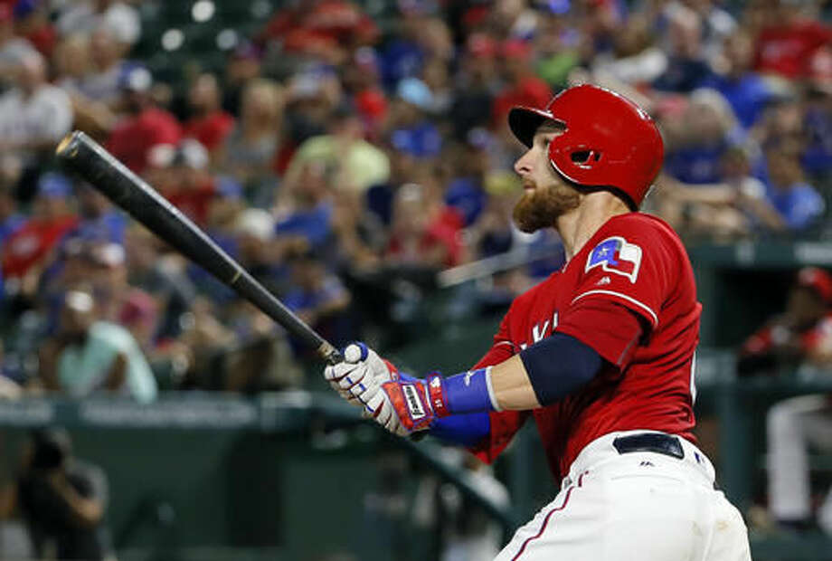Texas Rangers' Jonathan Lucroy watches the flight of his two-run home run off Detroit Tigers' Anibal Sanchez during the third inning of a baseball game, Friday, Aug. 12, 2016, in Arlington, Texas. (AP Photo/Tony Gutierrez) Photo: Tony Gutierrez
