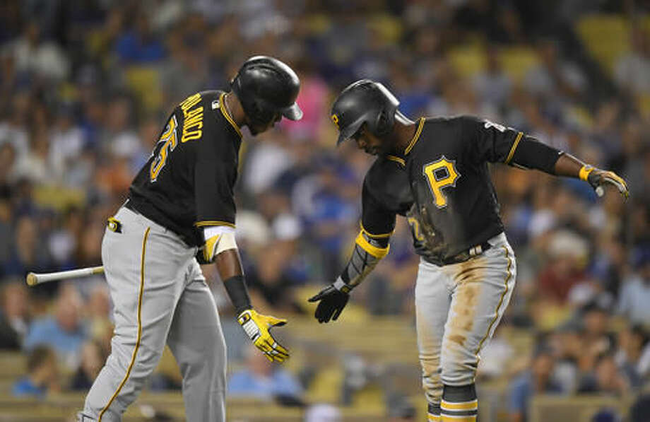 Pittsburgh Pirates' Andrew McCutchen, right, is congratulated by Gregory Polanco after hitting a solo home run during the third inning of a baseball game against the Los Angeles Dodgers, Friday, Aug. 12, 2016, in Los Angeles. (AP Photo/Mark J. Terrill) Photo: Mark J. Terrill