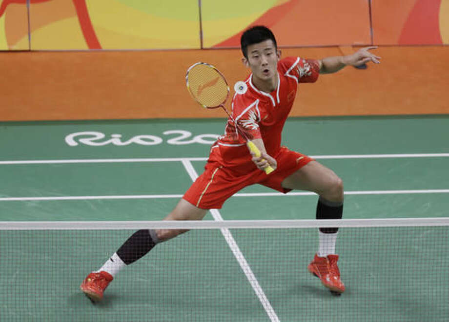 China's Chen Long returns a shot to Poland's Adrian Dziolko during a Men's single match at the 2016 Summer Olympics in Rio de Janeiro, Brazil, Saturday, Aug. 13, 2016. (AP Photo/Kin Cheung) Photo: Kin Cheung