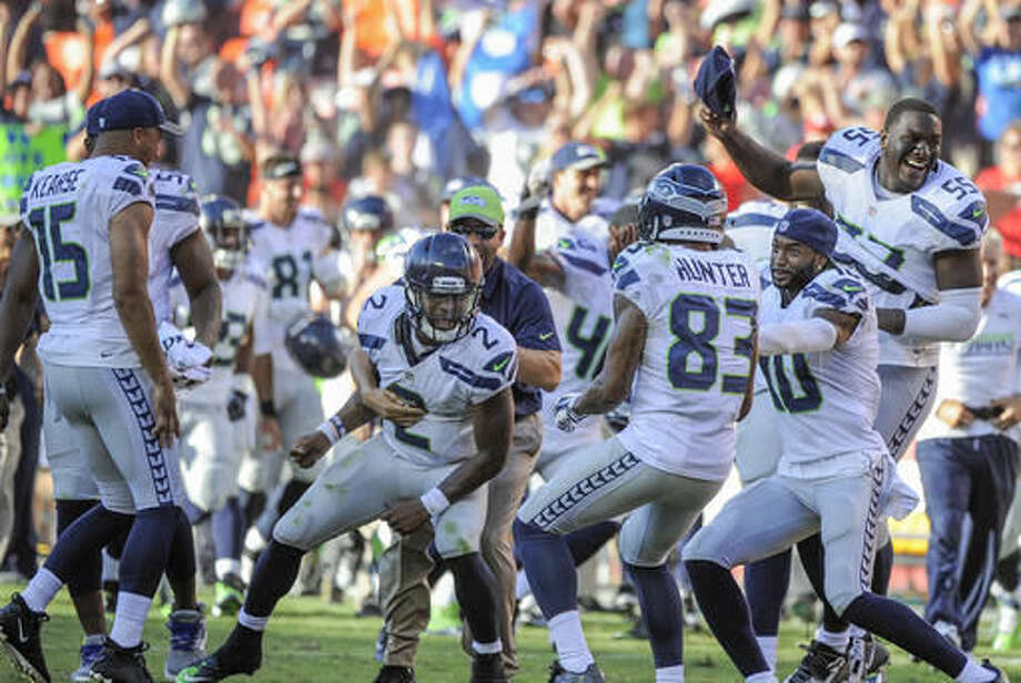Seattle Seahawks players, including quarterback Trevone Boykin (2) and defensive end Frank Clark (55), celebrate after running back Troymaine Pope scored on a two-point conversion with no time left in the second half of an NFL preseason football game in Kansas City, Mo., Saturday, Aug. 13, 2016. (AP Photo/Ed Zurga) Photo: Ed Zurga