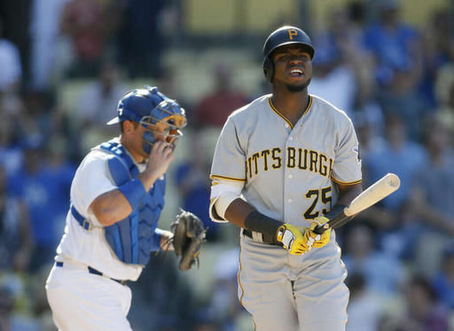Pittsburgh Pirates right fielder Gregory Polanco, right, reacts after striking out on a pitch from Los Angeles Dodgers relief pitcher Kenley Jansen to end the game in the ninth inning in front of Los Angeles Dodgers catcher A.J. Ellis, left, Saturday, Aug. 13, 2016, in Los Angeles. The Dodgers won 8-4. (AP Photo/Danny Moloshok)2 Photo: Danny Moloshok