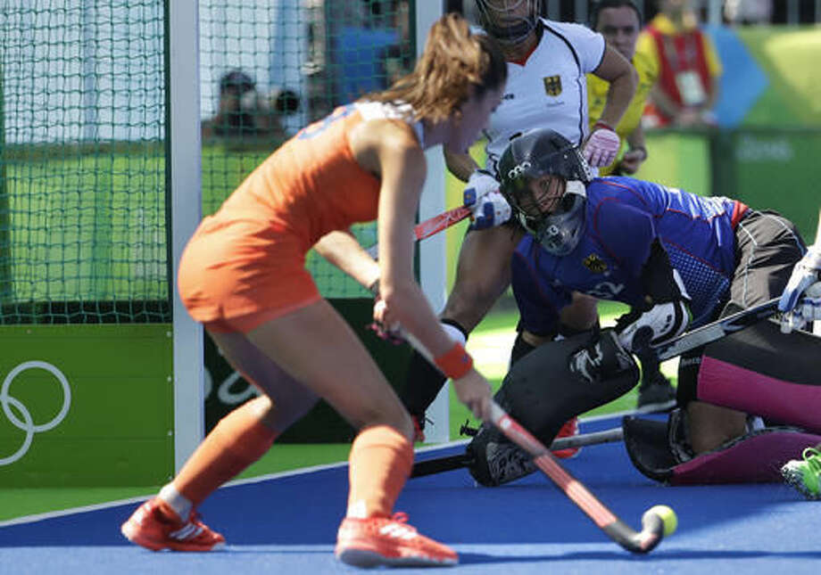 German's goalkeeper Kristina Reynolds, right, looks to Netherlands' Marloes Keetels, left, shoots the ball during a women's field hockey match at 2016 Summer Olympics in Rio de Janeiro, Brazil, Saturday, Aug. 13, 2016. (AP Photo/Hussein Malla) Photo: Hussein Malla