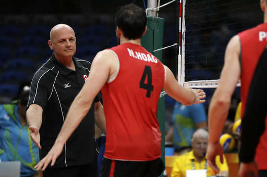 Canada head coach Glenn Hoag, left, goes to shake hands with his son Nicholas Hoag after a men's preliminary volleyball match against Mexico at the 2016 Summer Olympics in Rio de Janeiro, Brazil, Saturday, Aug. 13, 2016. (AP Photo/Matt Rourke) Photo: Matt Rourke
