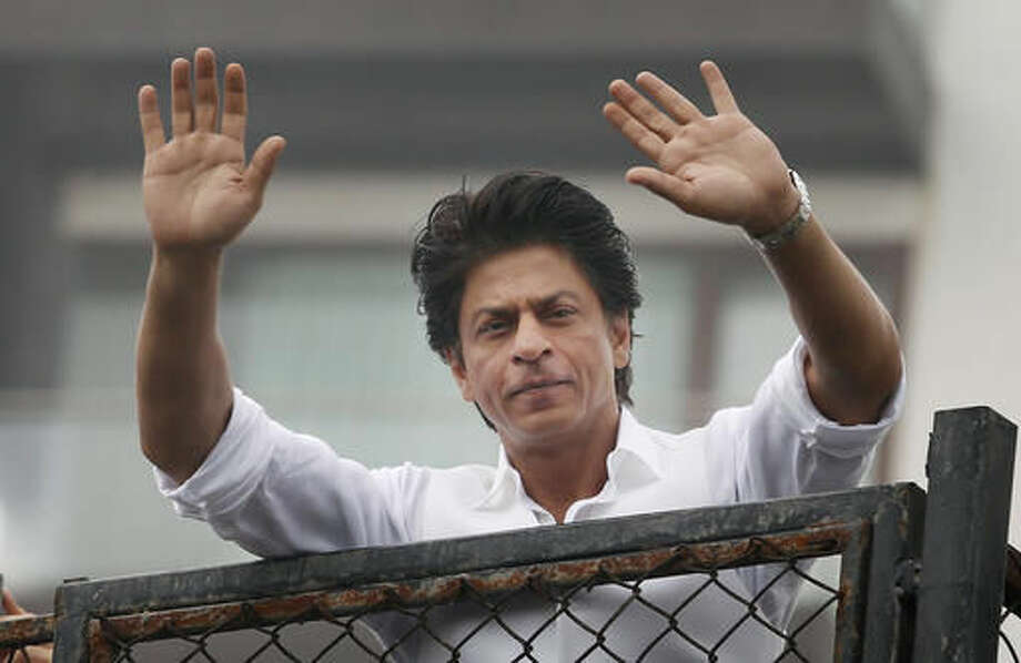 """FILE - In this Thursday, July 7, 2016, file photo, Bollywood actor Shah Rukh Khan greets fans waiting outside his residence on Eid al-Fitr in Mumbai, India. Bollywood superstar Khan has tweeted that he gets detained at U.S. airports """"every damn time"""" after he was stopped at the Los Angeles International Airport. The U.S. Ambassador to New Delhi Richard R. Verma tweeted an apology to the star Friday, Aug. 12, saying that the government was working to """"to ensure it doesn't happen again."""" (AP Photo/Rajanish Kakade, File ) Photo: Rajanish Kakade"""