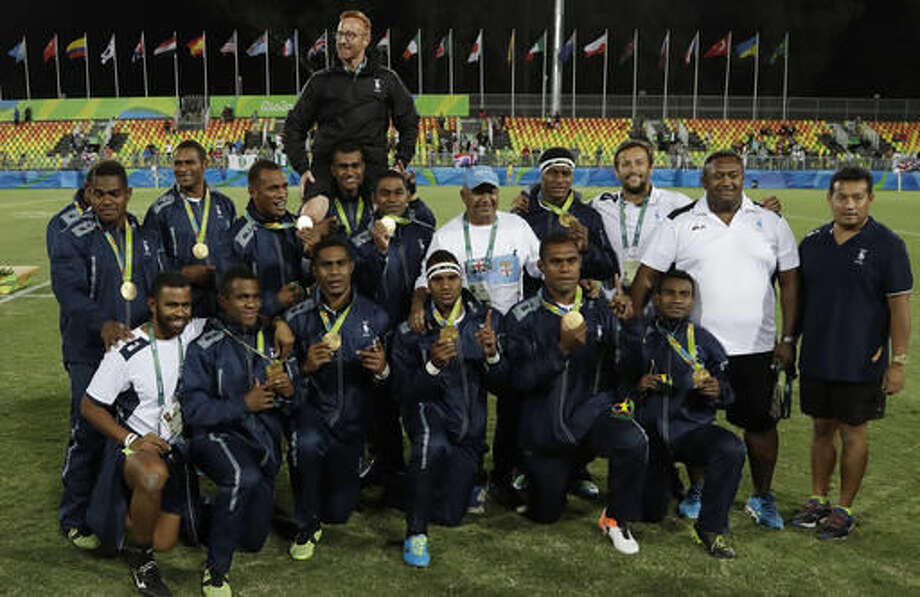 Fiji's team phase for a group photograph after winning the men's rugby sevens gold medal match against Britain at the Summer Olympics in Rio de Janeiro, Brazil, Thursday, Aug. 11, 2016. (AP Photo/Themba Hadebe) Photo: Themba Hadebe