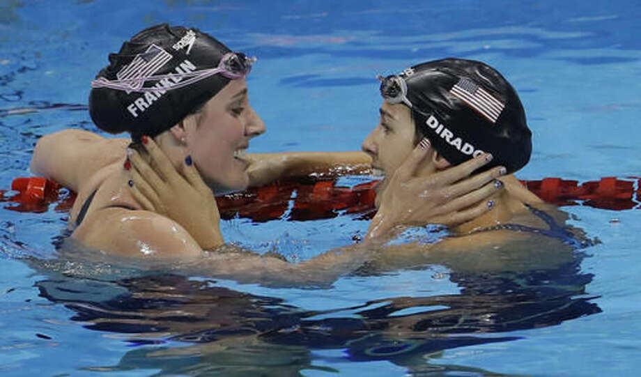 United States' Missy Franklin, left, and United States' Maya DiRado greet each other after a semifinal of the women's 200-meter backstroke during the swimming competitions at the 2016 Summer Olympics, Thursday, Aug. 11, 2016, in Rio de Janeiro, Brazil. (AP Photo/Natacha Pisarenko) Photo: Natacha Pisarenko