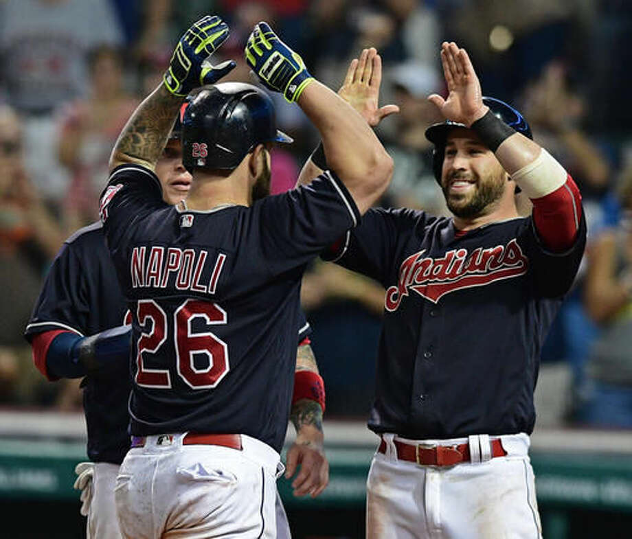 Cleveland Indians' Mike Napoli celebrates with Jason Kipnis, right, and Roberto Perez, left, after hitting a three-run home run during the fifth inning of a baseball game against the Los Angeles Angels, Thursday, Aug. 11, 2016, in Cleveland. (AP Photo/David Dermer) Photo: David Dermer