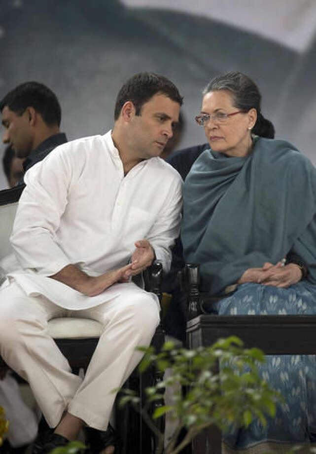 FILE- In this Nov. 14, 2015, file photo, Congress party President Sonia Gandhi, right, listens to her son and party Vice President Rahul Gandhi during celebrations marking the birth anniversary of the first Indian Prime Minister Jawaharlal Nehru in New Delhi, India. Following a string of stinging electoral defeats, the 131-year old Congress party - which has led India for nearly three-fourths of its modern history - is foundering. Several senior leaders have quit the party, accusing its leadership of failing to connect with the masses. And the blame is increasingly falling on the Gandhis, the family that has commanded the Congress party since its inception. (AP Photo/Tsering Topgya, File) Photo: Tsering Topgyal