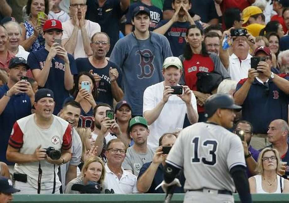 Fans react as New York Yankees' Alex Rodriguez (13) walks to the dugout after lining out during the second inning of a baseball game against the Boston Red Sox in Boston, Thursday, Aug. 11, 2016. (AP Photo/Michael Dwyer) Photo: Michael Dwyer