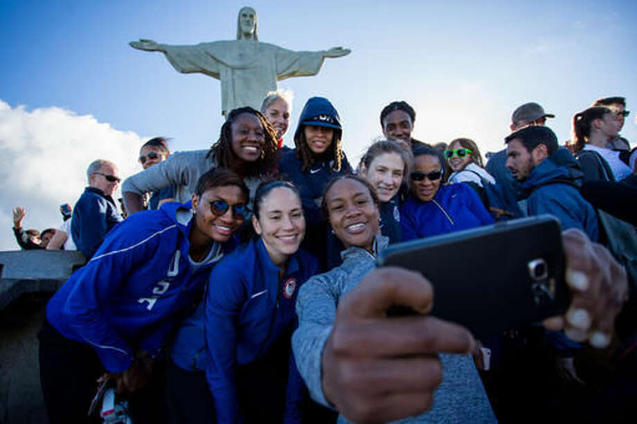 Members of the United States basketball women team visit the Christ the Redeemer statue during the 2016 Summer Olympics in Rio de Janeiro, Thursday, Aug.11, 2016. (AP Photo/Mauro Pimentel) Photo: Mauro Pimentel