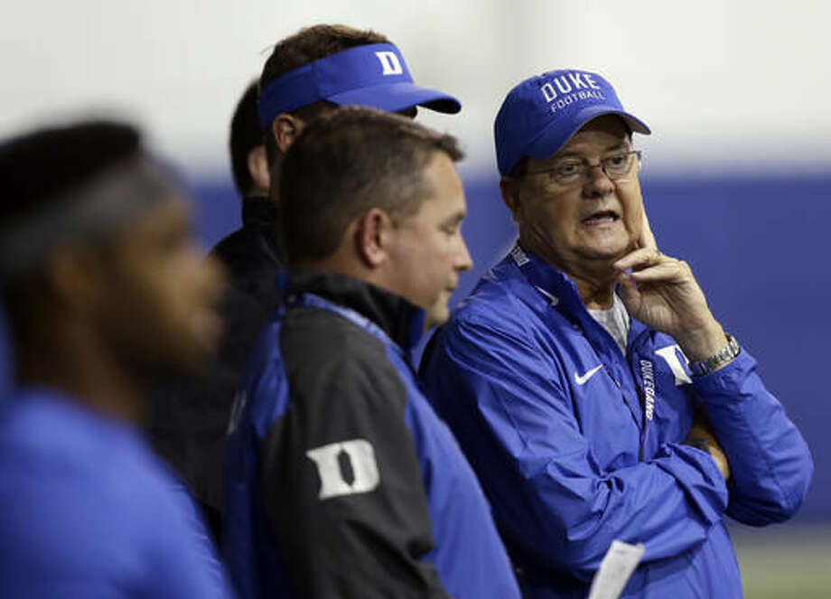 In this photo taken Monday, Aug. 8, 2016 Duke head coach David Cutcliffe, right, speaks with assistants during an NCAA college football practice in Durham, N.C. (AP Photo/Gerry Broome) Photo: Gerry Broome