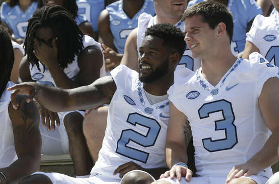 In this photo taken Saturday, Aug. 6, 2016 North Carolina's Des Lawrence (2) and Ryan Switzer (3) sit for a team photo during the NCAA college football team's media day in Chapel Hill, N.C. (AP Photo/Gerry Broome) Photo: Gerry Broome