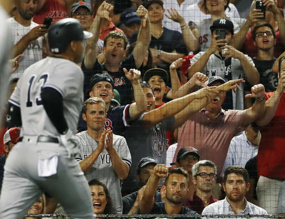 Fans react as New York Yankees' Alex Rodriguez heads back to the dugout after flying out against the Boston Red Sox during the seventh inning of a baseball game at Fenway Park in Boston on Wednesday, Aug. 10, 2016. (AP Photo/Winslow Townson) Photo: Winslow Townson