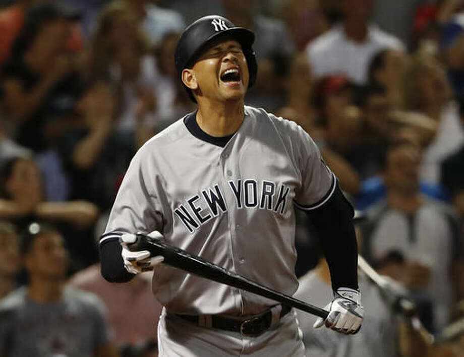 New York Yankees' Alex Rodriguez reacts to flying out as a pinch hitter during the seventh inning of a baseball game against the Boston Red Sox at Fenway Park in Boston on Wednesday, Aug. 10, 2016. (AP Photo/Winslow Townson) Photo: Winslow Townson