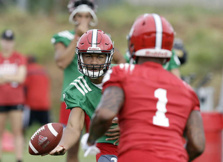 In this photo taken Monday, Aug. 1, 2016 North Carolina State quarterback Jalan McClendon tosses the ball to Jaylen Samuels (1) during an NCAA college football practice in Raleigh, N.C. (AP Photo/Gerry Broome) Photo: Gerry Broome