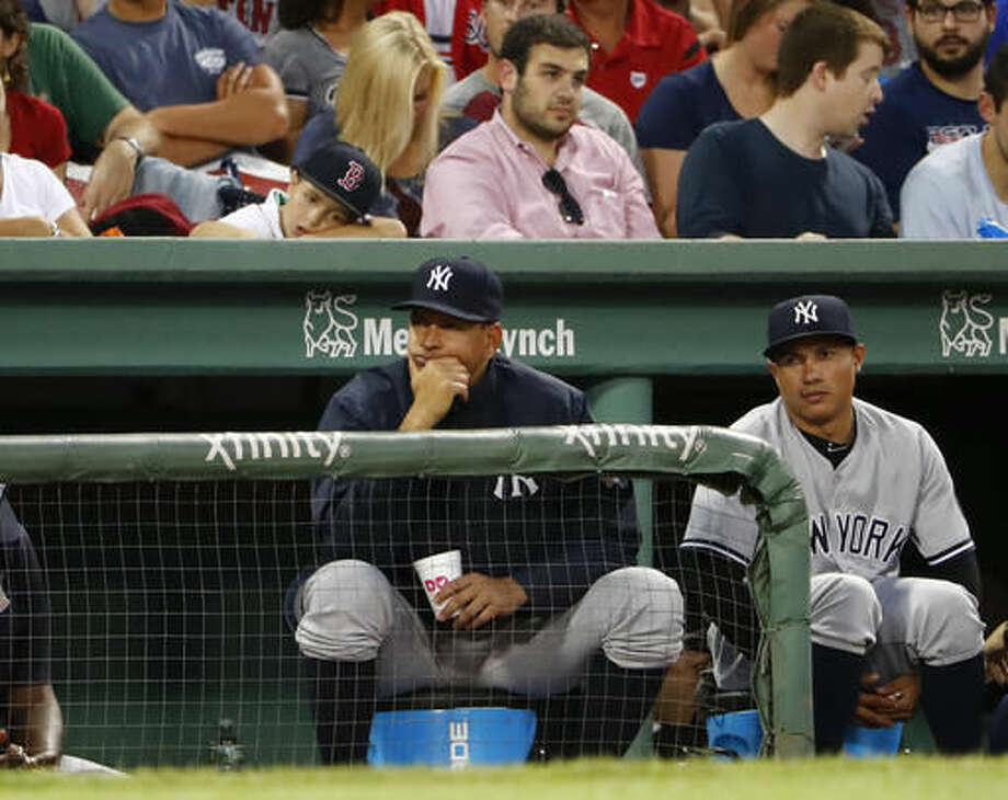 New York Yankees' Alex Rodriguez, center, watches from the dugout during the third inning of a baseball game against the Boston Red Sox at Fenway Park in Boston Wednesday, Aug. 10, 2016. (AP Photo/Winslow Townson) Photo: Winslow Townson