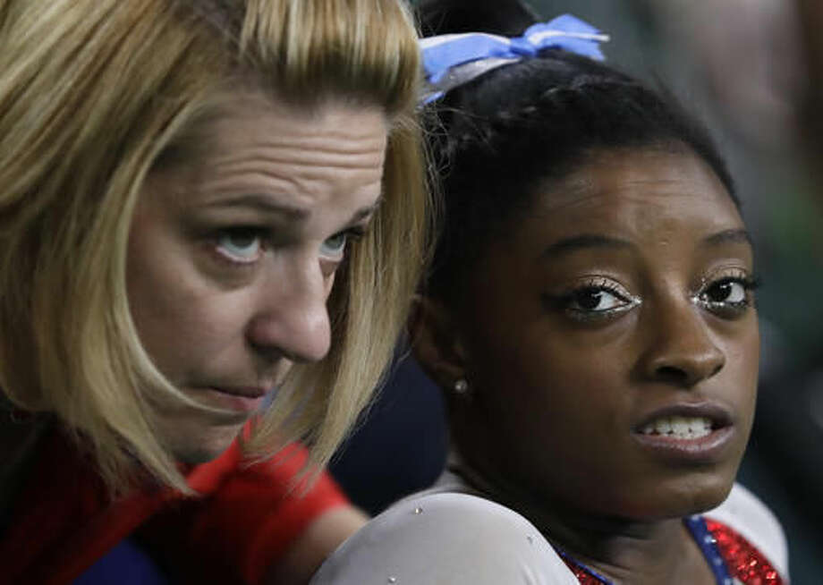 United States' Simone Biles speaks with her coach Aimee Boorman during the artistic gymnastics women's individual all-around final at the 2016 Summer Olympics in Rio de Janeiro, Brazil, Thursday, Aug. 11, 2016. (AP Photo/Dmitri Lovetsky) Photo: Dmitri Lovetsky