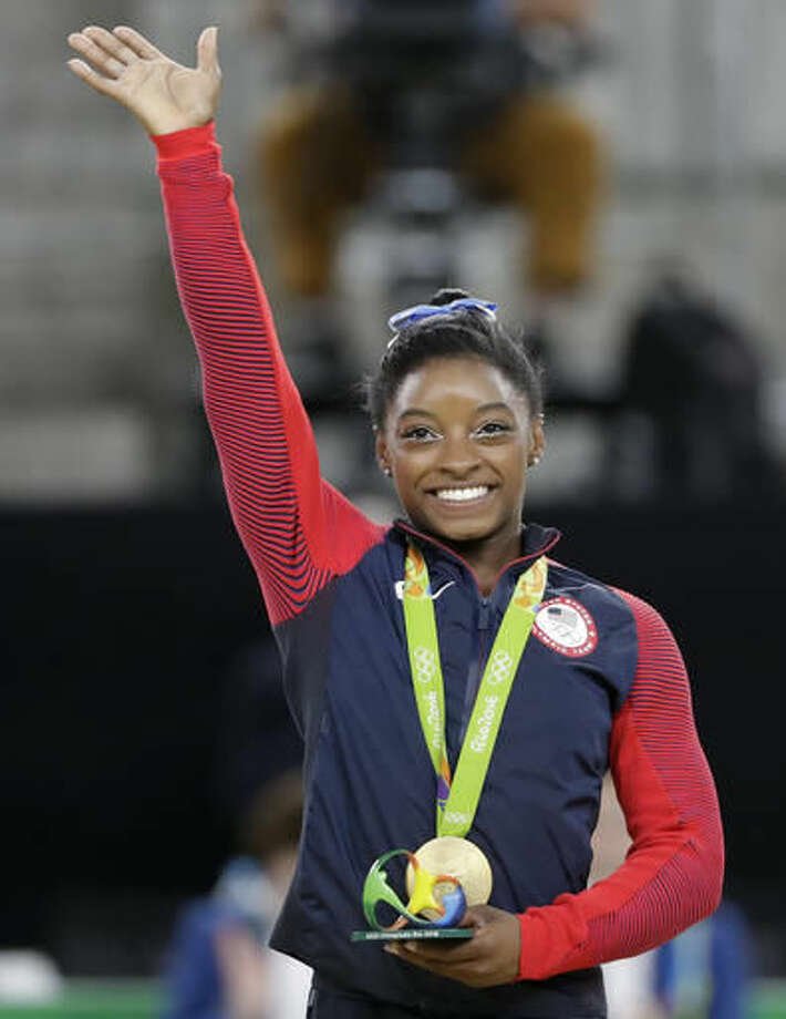 United States' Simone Biles waves on the podium after receiving her gold medal in the artistic gymnastics women's individual all-around final at the 2016 Summer Olympics in Rio de Janeiro, Brazil, Thursday, Aug. 11, 2016. (AP Photo/David Goldman) Photo: David Goldman