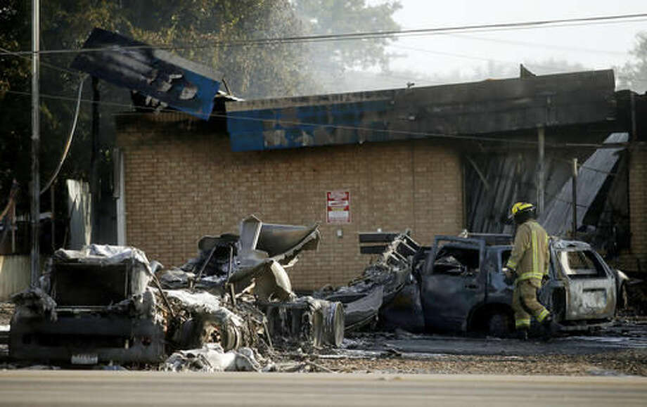 A firefighter works the scene of a fire after a tanker truck exploded at Mickey's Convenience Store, in Killeen, Texas, Friday, Aug. 12, 2016. Police say preliminary information indicates the tanker truck was refueling the gas pumps when it was struck by an SUV. (Eric J. Shelton /The Killeen Daily Herald via AP) Photo: Eric J. Shelton | Herald