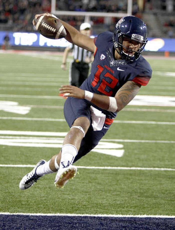 FILE - In this Nov. 14, 2015, file photo, Arizona quarterback Anu Solomon scores a touchdown against Utah during the second half of an NCAA college football game in Tucson, Ariz. (AP Photo/Rick Scuteri, file) Photo: Rick Scuteri