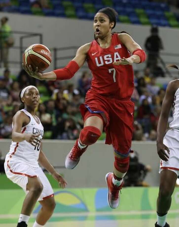 United States forward Maya Moore makes a layup during the first half of a women's basketball game against Canada at the Youth Center at the 2016 Summer Olympics in Rio de Janeiro, Brazil, Friday, Aug. 12, 2016. (AP Photo/Carlos Osorio) Photo: Carlos Osorio