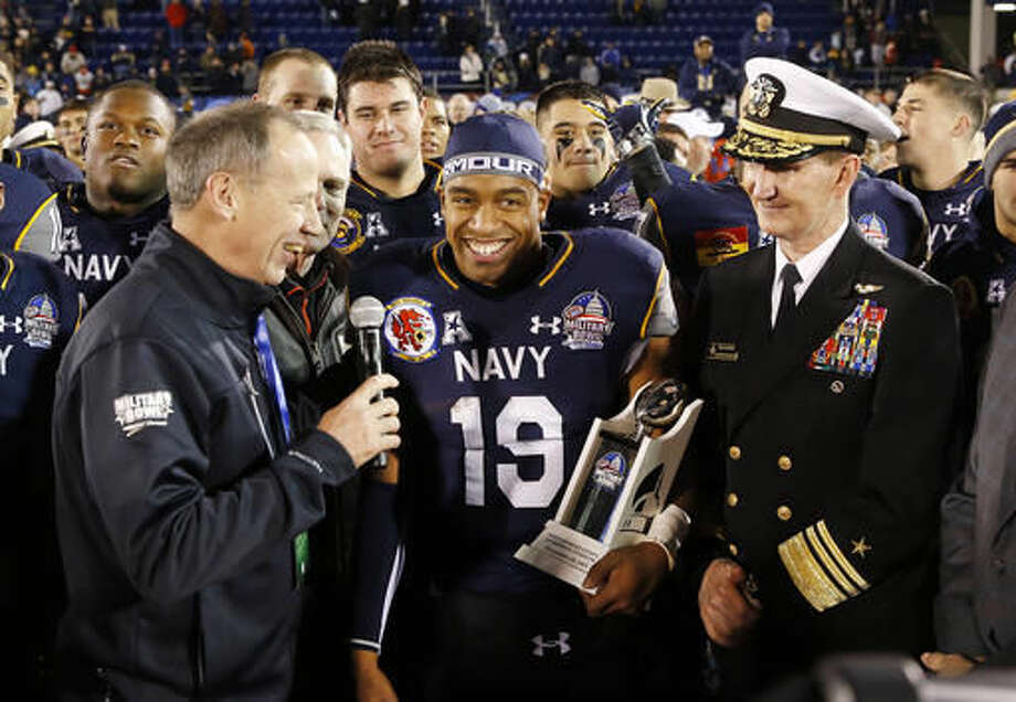 FILE - This Dec. 28, 2015, file photo shows Navy quarterback Keenan Reynolds (19) holding a trophy after being named Most Valuable Player after the Military Bowl NCAA college football game against Pittsburgh in Annapolis, Md. To no one's surprise, the very first question asked of Navy coach Ken Niumatalolo at media day involved replacing quarterback Keenan Reynolds. (AP Photo/Patrick Semansky, file) Photo: Patrick Semansky