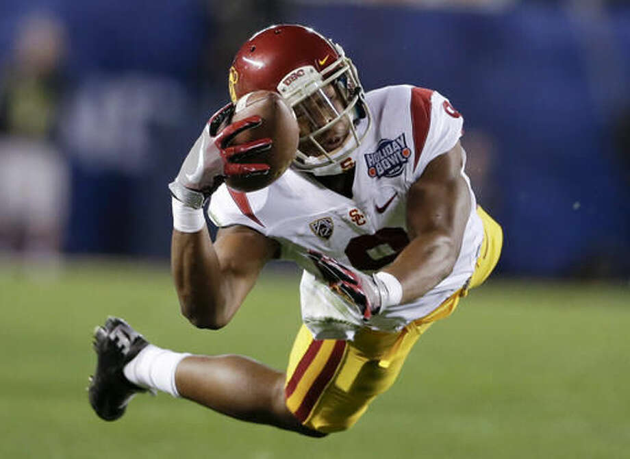 FILE - In this Dec. 30, 2015, file photo, Southern California wide receiver JuJu Smith-Schuster drops a pass during the first half of the Holiday Bowl NCAA college football game against Wisconsin in San Diego, Calif. (AP Photo/Gregory Bull, file) Photo: Gregory Bull