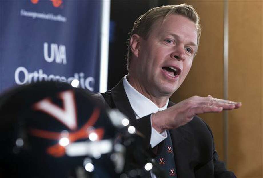 FILE - In this Dec. 7, 2015, file photo, Virginia coach Bronco Mendenhall speaks during an NCAA college head football news conference in Charlottesville, Va. Mendenhall arrives from BYU to lead a program with one winning season in eight years. (AP Photo/Steve Helber, File) Photo: Steve Helber