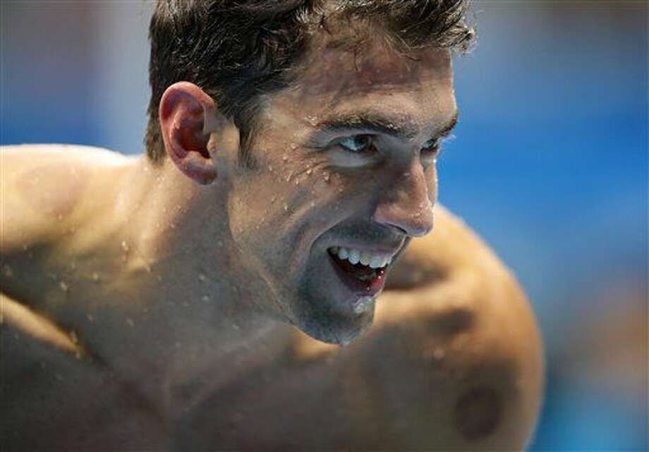 El nadador estadounidense Michael Phelps sale de la piscina tras competir en los 100 metros mariposa el jueves, 11 de agosto de 2016, en Río de Janeiro. (AP Photo/Lee Jin-man) Photo: Lee Jin-man