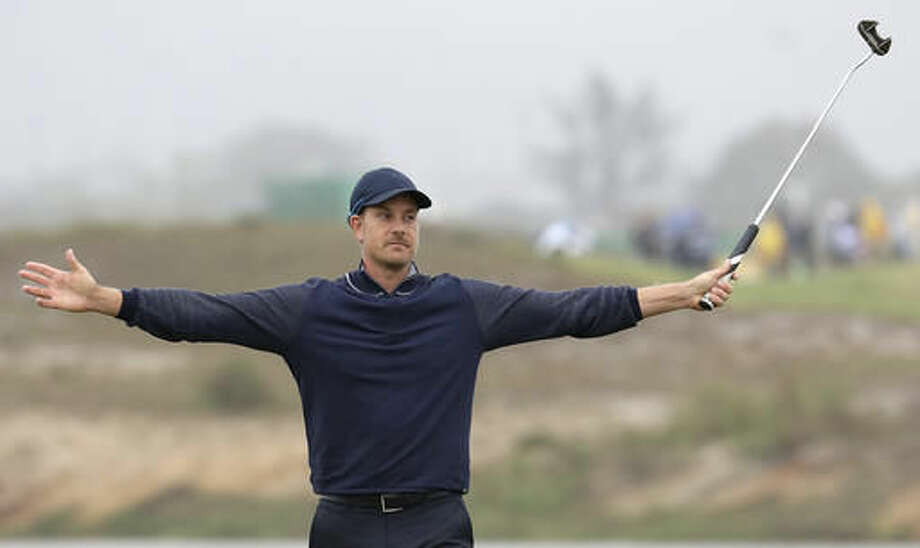 Henrik Stenson of Sweden reacts to making a putt for par on the third hole during the second round of the men's golf event at the 2016 Summer Olympics in Rio de Janeiro, Brazil, Friday, Aug. 12, 2016. (AP Photo/Alastair Grant) Photo: Alastair Grant