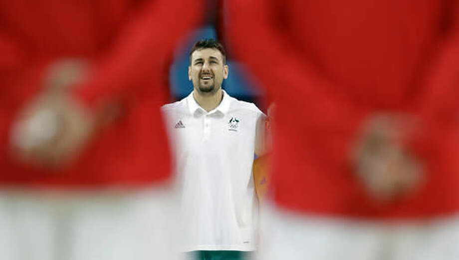 Australia's Andrew Bogut wears street cloths as he stands for the national anthem before a men's basketball game against China at the 2016 Summer Olympics in Rio de Janeiro, Brazil, Friday, Aug. 12, 2016. (AP Photo/Eric Gay) Photo: Eric Gay