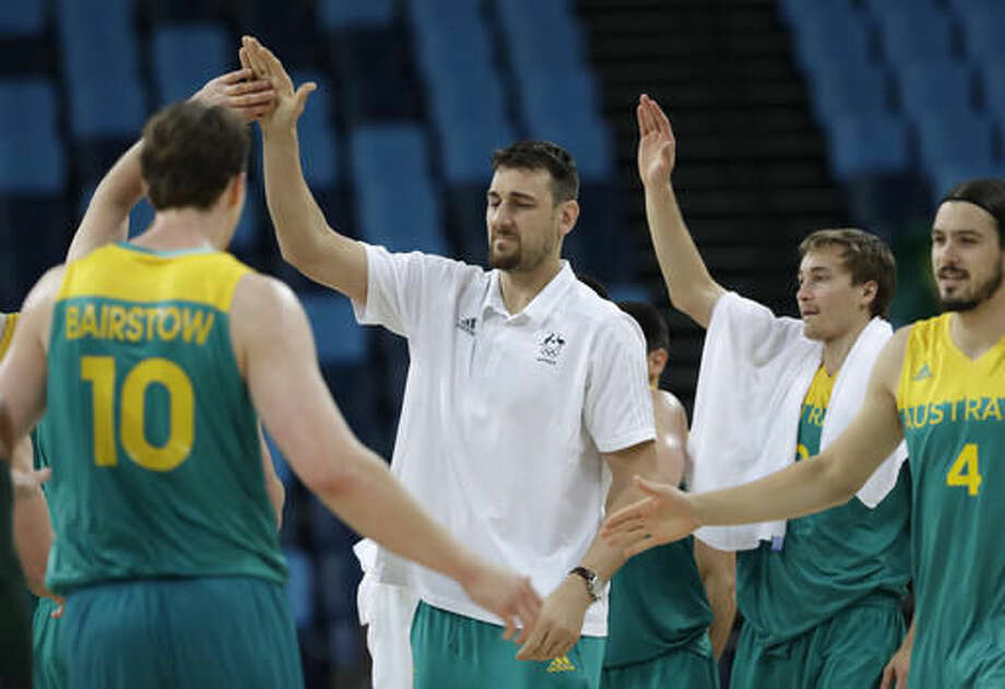 Australia's Andrew Bogut, center, wears steet cloths and did not play against China during a men's basketball game at the 2016 Summer Olympics in Rio de Janeiro, Brazil, Friday, Aug. 12, 2016. (AP Photo/Eric Gay) Photo: Eric Gay