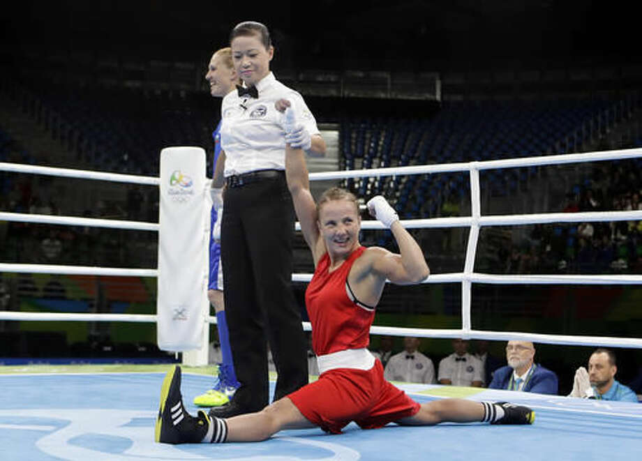 Ukraine's Tetyana Kob, right, celebrates as she won a match against Bulgaria's Stanmira Petrova during a women's flyweight 51-kg preliminary boxing match at at the 2016 Summer Olympics in Rio de Janeiro, Brazil, Friday, Aug. 12, 2016. (AP Photo/Frank Franklin II) Photo: Frank Franklin II