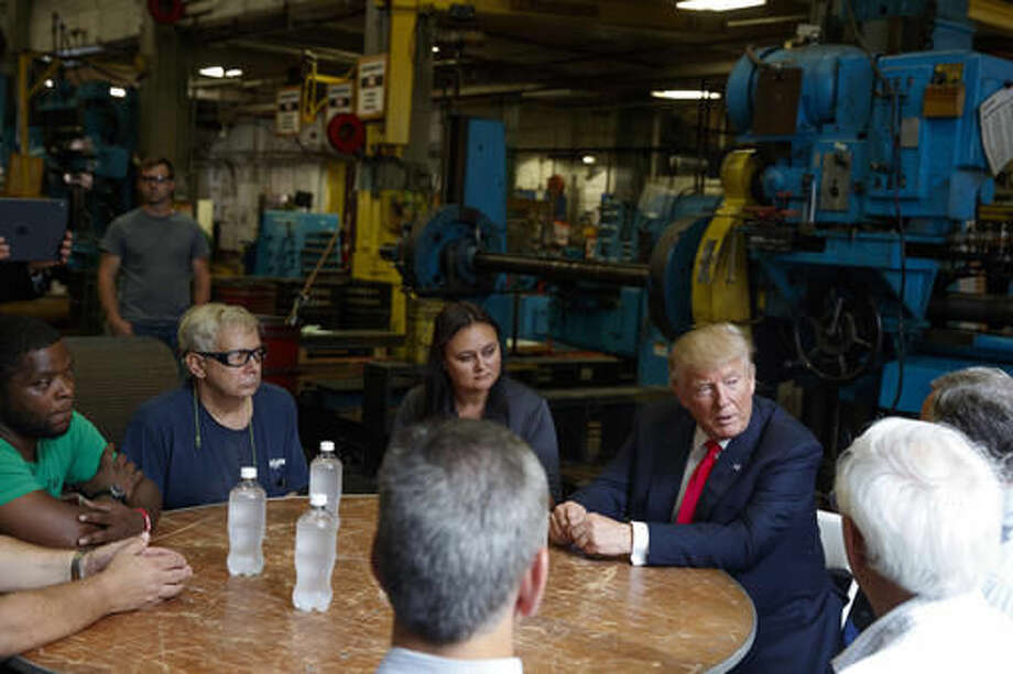 Republican presidential candidate Donald Trump talks with a group of factory workers during a tour of McLanahan Corporation headquarters, a company that manufactures mineral and agricultural equipment, Friday, Aug. 12, 2016, in Hollidaysburg, Pa. (AP Photo/Evan Vucci) Photo: Evan Vucci