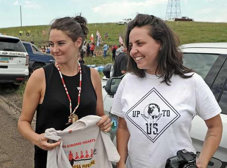 Up To Us founders actress Shailene Woodley, left, and filmaker Ann Kleinhenz were at the protest of the Dakota Access Pipeline on Thursday. The pipeline would start in North Dakota and pass through South Dakota and Iowa before ending in Illinois. Construction of the pipeline began this week just north of the Standing Rock Sioux reservation. Nearly 200 people came from across the country to join in the protest. (Tom Stromme/The Bismarck Tribune via AP) Photo: Tom Stromme